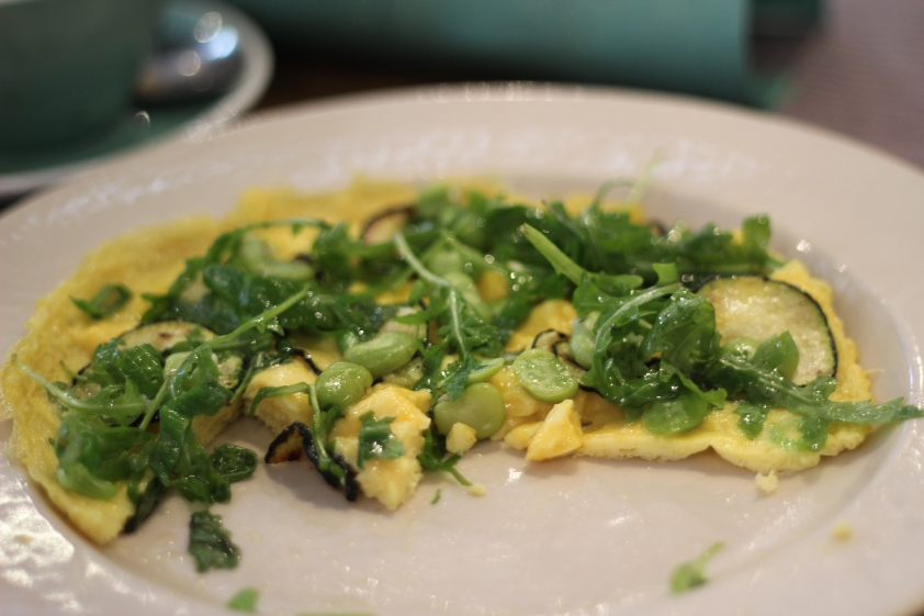 Omelette with rocket and broad beans and courgettes